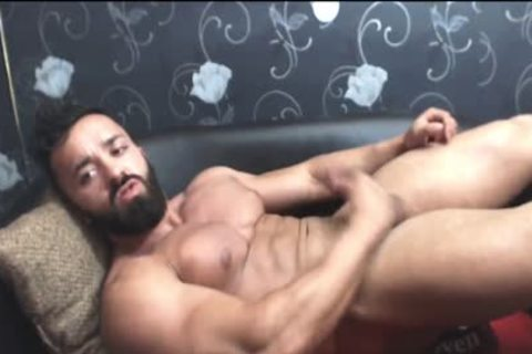 Bearded pumped up stud Strokes His big weenie
