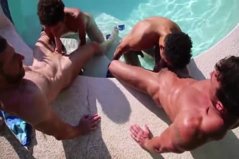 two men pounding two Latino twinks in nature's garb
